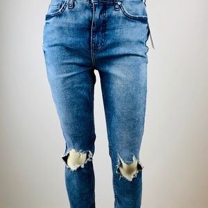 Free People distressed blue jeans.